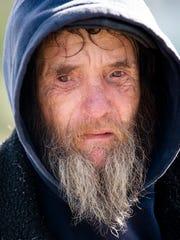 Dean Best, a homeless man, speaks to Lakeesa Butler,