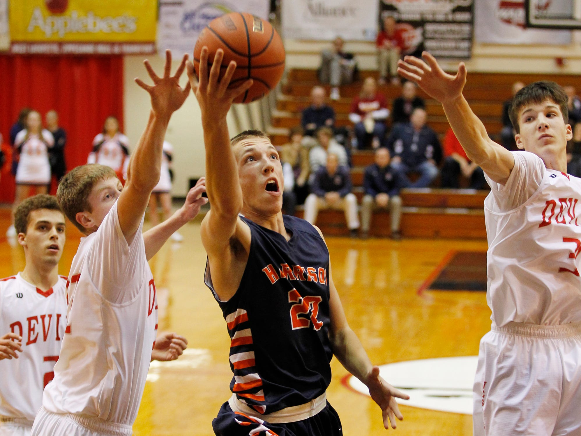 Harrison's Jakub Hall with a drive to the basket against West Lafayette in the J&C Hoops Classic Tuesday, December 1, 2015, at Lafayette Jeff. Harrison defeated West Lafayette 52-40.