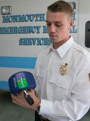 James Dolan, 2nd Lt. on the Monmouth Beach 1st aid squad, helped save the life of resident Doug Murphy who was having a heart attack. Dolan used a new device, the ResQCPR. The system increases the effectiveness of CPR —June 20, 2016 -Monmouth Beach, NJ.-Staff photographer/Bob Bielk/Gannett NJ