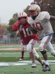 Cynthia Cheng (red jersey) competes during a 2012 Edison High School football practice