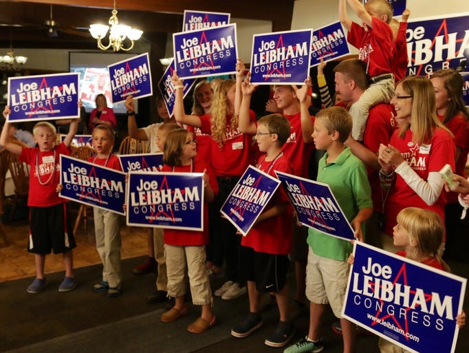 Leibham family members lead the cheers at Tuesday night's election party at the Town and Country Club.