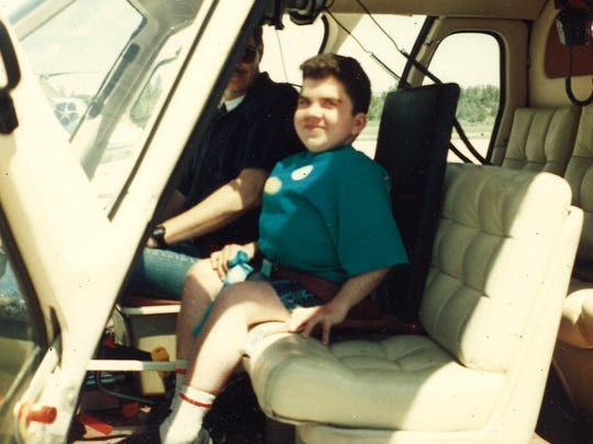 Brent Larsen, in the seat of a plane on a Make-a-Wish foundation trip at the Grand Canyon in Spring of 1996.
