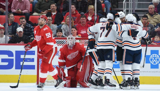 Nov 22, 2017; Detroit, MI, USA; Oilers center Mark Letestu (55) celebrates with teammates after scoring a goal in the second period against the Red Wings at Little Caesars Arena.