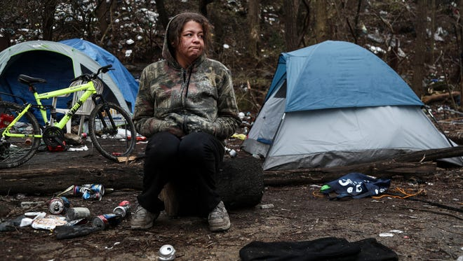 Kneasha Taylor, 33, has been homeless for years. She lives with her fiancé in a camp that's set up among other homeless people in a wooded area that will be the site for the proposed soccer stadium.