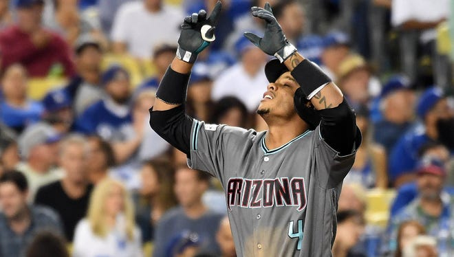 Ketel Marte celebrates after hitting a solo home run in the seventh inning off Clayton Kershaw.