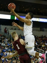 Jaaron Simmons scores a layup in the first half against Montana on Thursday. Next up for the Wolverines is Houston on Saturday night.