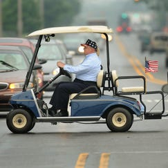 Larry Terwillegar, city council president of Gas City, uses a electric golf card to get around town as an alternative to using his car and paying high gas prices. The small northeast Indiana town passed an ordinance to allow golf carts on the city street in 2008.