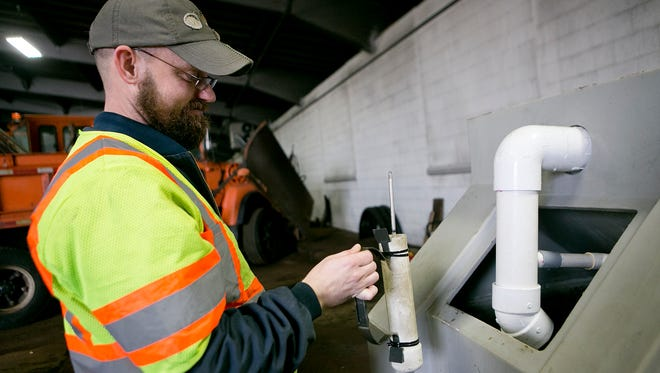 Joachim Mangen checks the hydrometer for the density of the salt in the water next to the brine maker at the Wood County Highway Department in Wisconsin Rapids, Wednesday, Nov. 18. Brine is the salt-water solution the department uses to spray the roads.