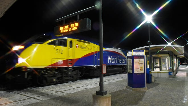 The Northstar commuter train pulls into the Big Lake Station Friday, Feb. 12, with the last commuters of the day in Big Lake. The photo was taken with a star filter to flare the lights.