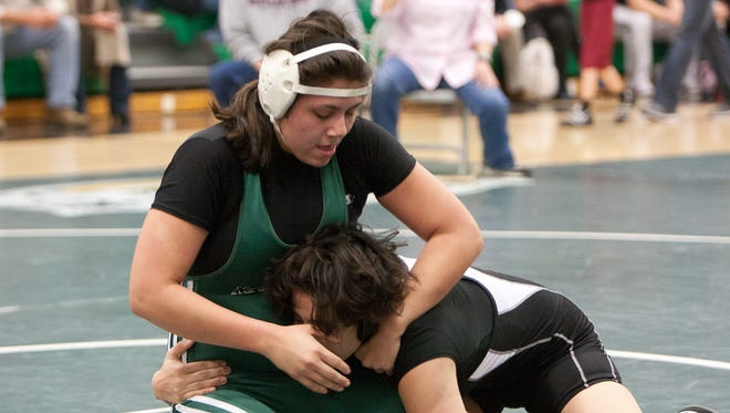 Pennsylvania should have a girls wrestling program, as some other states do. In this photo, North High School student Victoria Baker, 18, wrestles during the Iowa Girls' Wrestling Association state championship, March 11, 2012, at North High School.