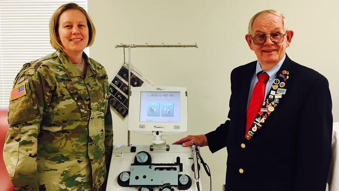 Maj. Jennifer Marin, officer in charge of the Fort Bliss Blood Donor Center, and Al Whitney, who is visiting different military bases and preaching his message of donating blood.