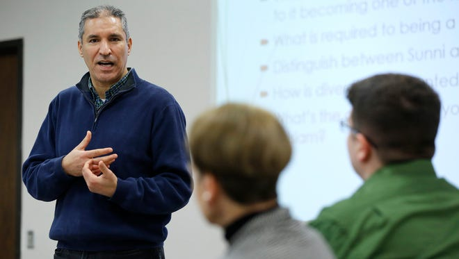 Ahmed Idressi Alami, director of the Arabic Program at Purdue University, presents a program on Islam during the Diversity Roundtable meeting Thursday, March 3, 2016, at the YWCA of Greater Lafayette. Alami said there is no ground for hatred in Islam as he discussed several aspects of the religion and its history.