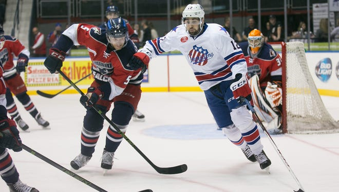 Amerks center Eric O'Dell, right, scored Rochester's first goal in the 3-1 victory over Utica.