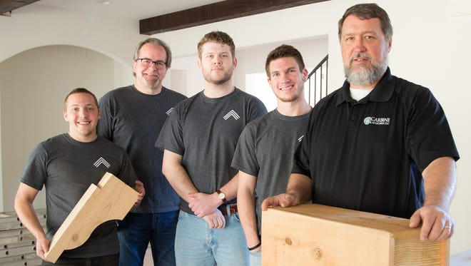 Builders Carbine & Associates are partnering with young men from Narrow Gate Artisans to produce box beams and corbels for a custom home project in Franklin. Left to right, Brent Brown; Phil Stoner, president of Narrow Gate Artisans; Burke Reynolds; Blake Smith; and Daryl Walny, Carbine's vice president of operations.