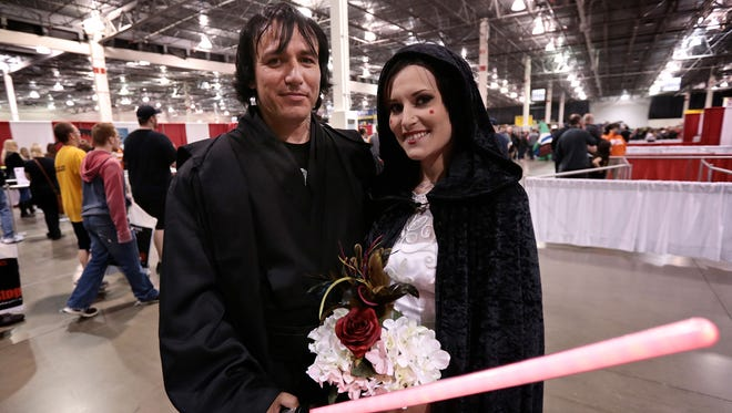 """David Waite, 39, and Olivia Vance, 26, both of White Lake, Mich., before their wedding Sunday, May 15, 2016, during the Motor City Comic Con 2016 at the Suburban Collection Showplace in Novi, Mich. Waite, who was dressed as Anakin Skywalker, and Vance, dressed as Padme Amidala, the mother of Luke Skywalker and Princess Leia, celebrated their wedding with a """"Star Wars"""" theme."""