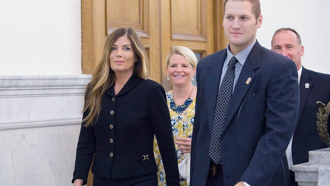 Pennsylvania Attorney General Kathleen Kane, left, walks down a hall at the Montgomery County Courthouse Monday in Norristown, Pennsylvania. Kane was found guilty of all charges in her perjury and obstruction trial.