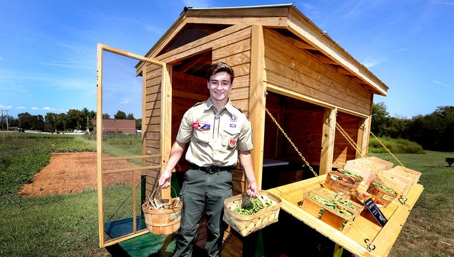 Boy Scout Casey Couch stands with a veggie cart, on Thursday, Sept. 15, 2016, that he built for Journey Home, so that they can sell their fresh vegetables. Couch completed as his Eagle Scout Project.