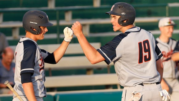 Harrison's Bobby Dearing, right, is congratulated by