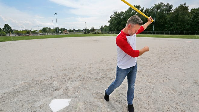 Chris Bradford takes an imaginary swing at a ball Thursday, July 13, 2017, at Arni Cohen Fields in West Lafayette. Bradford is organizing a wiffle ball tournament for July 22. The tournament will raise funds for playground equipment for Happy Hollow Park.