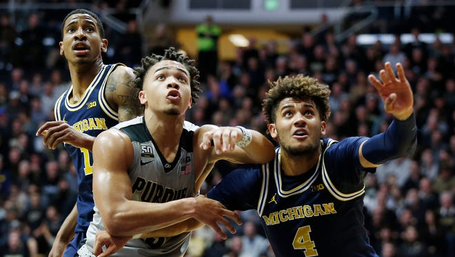 Carsen Edwards of Purdue and Isaiah Livers of Michigan jockey for rebounding position Thursday, January 25, 2018, at Mackey Arena.