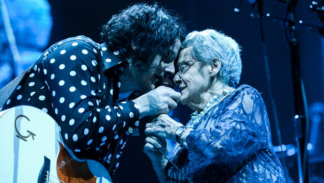 """Jack White (left) sings with his mother, Teresa Gillis, during a performance of """"Hotel Yorba"""" at Little Caesars Arena in Detroit on April 19, 2018."""