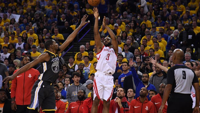 Houston Rockets guard Chris Paul (3) shoots over Golden State Warriors forward Kevin Durant (35) during the second quarter in game four of the Western conference finals of the 2018 NBA Playoffs at Oracle Arena.