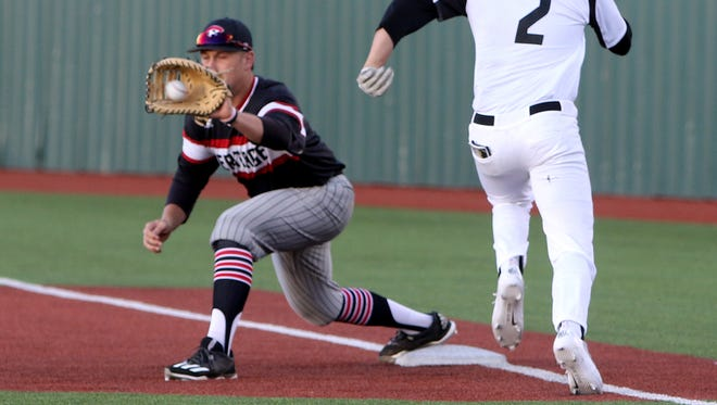 The throw to Colleyville Heritage first baseman Cameron Ehringer beats Rider's Parker Kelly in Game 1 of the Region I-5A area series Thursday, May 11,2017, at Hoskins Field. The Panthers defeated the Raiders 3-0.