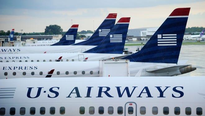 U.S. Airways planes await their passengers at the airport.