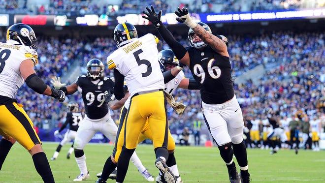 Nov 4, 2018; Baltimore, MD, USA; Pittsburgh Steelers quarterback Josh Dobbs (5) throws a pass over Baltimore Ravens defensive end Brent Urban (96) at M&T Bank Stadium. Mandatory Credit: Evan Habeeb-USA TODAY Sports