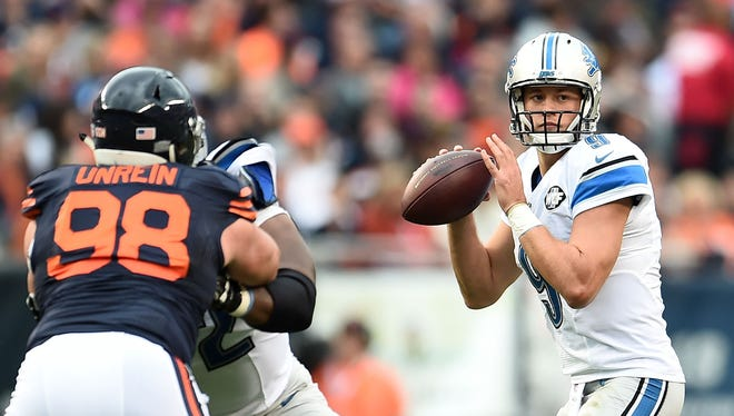Lions quarterback Matthew Stafford looks to pass during the first half against the Bears at Soldier Field on Oct. 2, 2016 in Chicago.