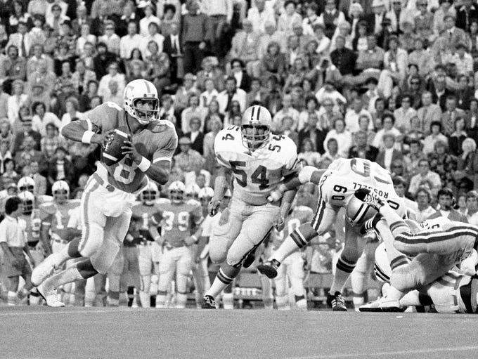 Tennessee quarterback Randy Wallace (8) heads up the