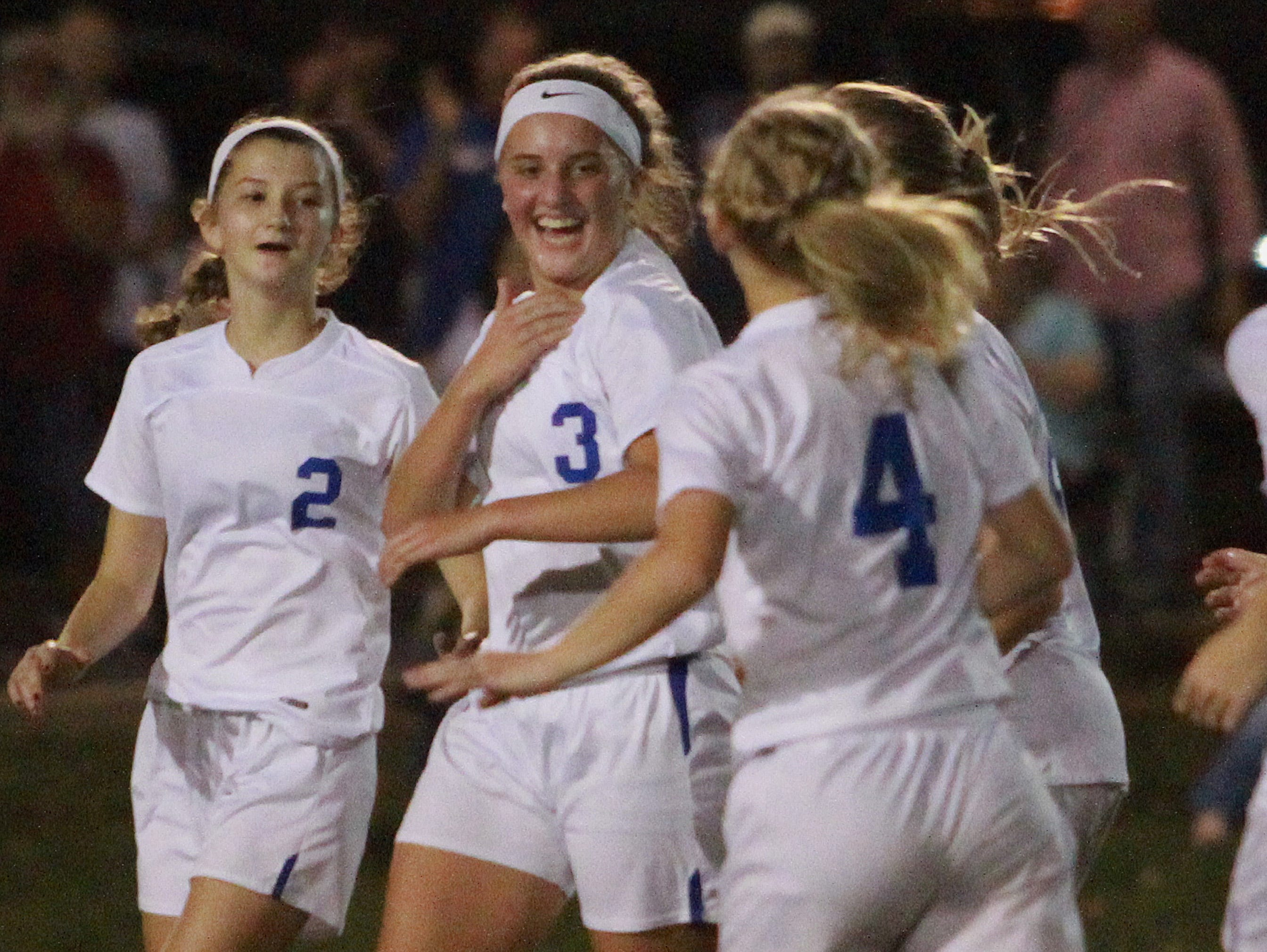 L-R White House's Shelby Deering, Mallory Humphries and Baylee Miller celebrate a goal against Hume-Fogg during Tuesday's Region 5 A-AA Tournament semifinal match.