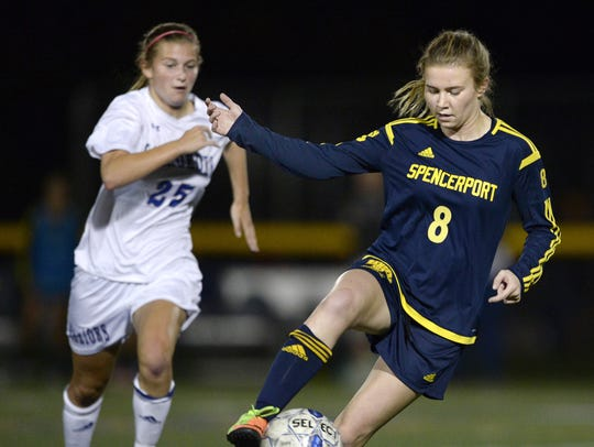 Spencerport's Leah Wengender, right, settles the ball while pressured by Webster Schroeder's Rachel Wengender. They're first cousins.