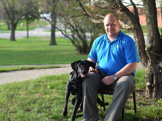 Wade Baker, here with his service dog Honor, died Aug. 19 after a shootout with police at a Haywood County church. He had struggled for years with severe PTSD and effects of a head injury.