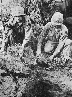 Sp/4 John Goelz (left) and Sgt. Jim Mertens were among the Redwood Falls National Guard company soldiers who took part in field training exercises held at Camp Ripley, as seen in this photo that first appeared in the June 23, 1970 edition of the Redwood Gazette.