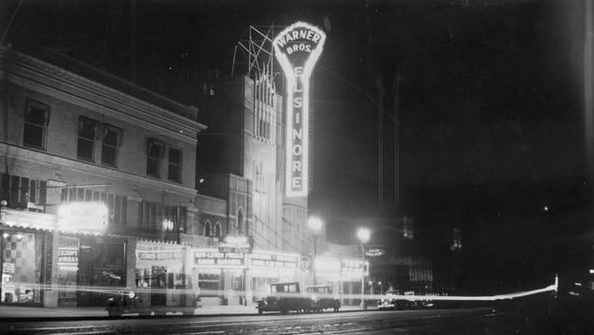 The Elsinore Theatre is seen with its Warner Bros. marquee lighted in the early 1930s.