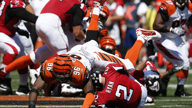 Cincinnati Bengals defensive end Carlos Dunlap (96) sacks the Atlanta Falcons quarterback Matt Ryan (2) in the first half at Paul Brown Stadium.