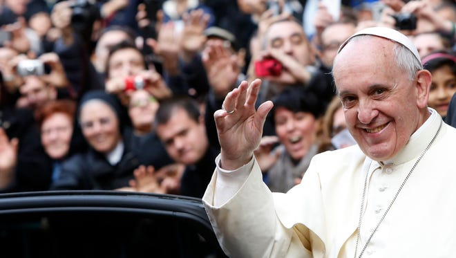 Pope Francis waves to the crowd in Rome on Friday.