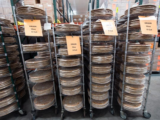 Frozen pizzas awaits delivery to schools at Mickey's