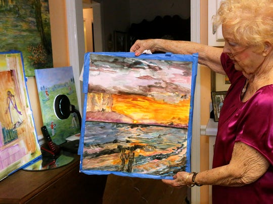 Betty Lee, an Alive Hospice patient, shows off the artwork she has been creating for 50 years during a tour of her home.
