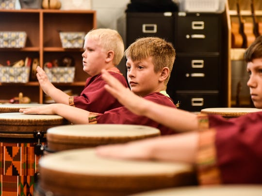 """Students in Elgin Elementary School's Cosmic Beat, an African drum and xylophone ensemble, perform Katy Perry's song """"Roar."""" The group is comprised of 17 fourth and fifth grade students at Elgin."""