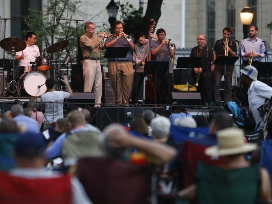 The Clifford Brown Trumpet Consortium plays at the Clifford Brown Jazz Festival Rodney Square on Tuesday. Mayoral candidates on Tuesday are holding a debate on arts and culture.