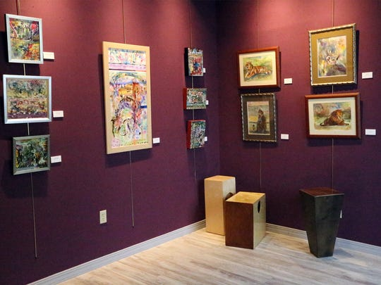 A corner inside the art gallery at Star City Studio Productions, 120 W. Castellano. The gallery, called the OM Room, also sells box-like Monk Drums.