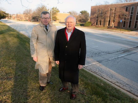 Tom Dewson (left) and Joe Kelly, who have fought plans to develop Barley Mill Plaza, stand at the office complex in 2013.