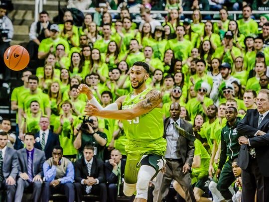 Denzel Valentine of MSU passes to a teammate as he