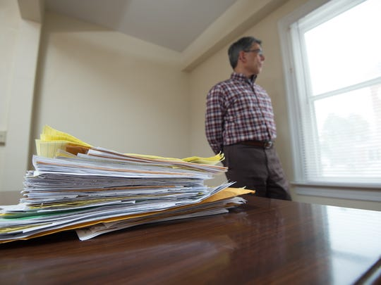 Stacks of complaints from nearly 100 inmates, as well as family members and others about reported abuse sit on the desk at Stephen Hampton's law firm, Grady & Hampton, LLC, Attorneys at Law in Dover.