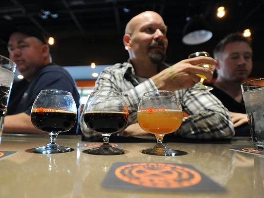Randy Stanley, a patron of Black Bottle Brewing, samples