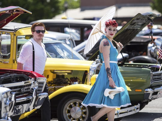 Mike Callahan and Allison McGuire walk through a row of classic cars at the Riverfront's Wilmo a Go-Go car show in 2014. The event returns next month for its seventh edition.