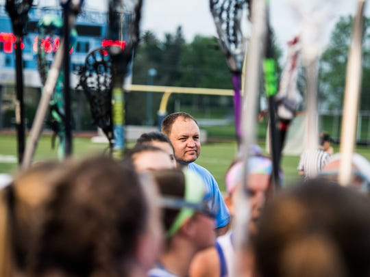 Dan Stoddard, head coach of the Cedar Crest girls lacrosse team, looks on as the team cheers before taking the field on Thursday, April 27, 2017.
