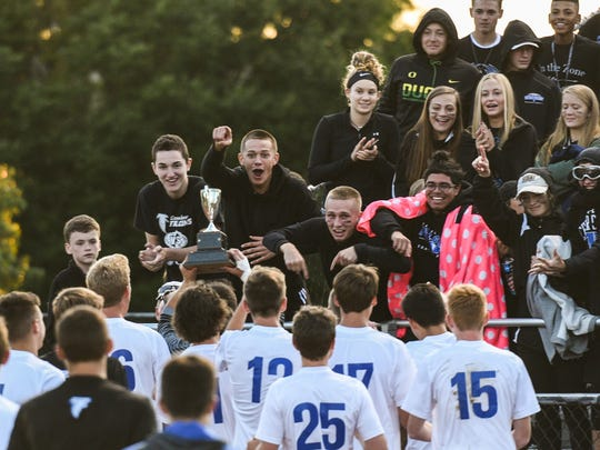 Cedar Crest boys celebrate with student section and the trophy as Cedar Crest beat Elco 1-0 in the annual Ritter-Hoffman Cup on Saturday  night.